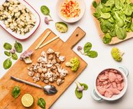 Food flat lay with spinach, chicken meat , chopped champignon and eggplant, lemon and vegetables Stock Photos