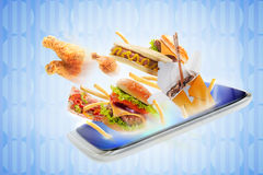 Food flying out of a touch screen Stock Images