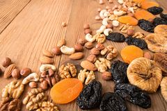 Free Food Frame Background With Dried Fruits And Nuts: Prunes, Apricots, Figs, Hazelnuts, Almond, Cashew, Walnut, Peanuts Over On Old Stock Photos - 101770323