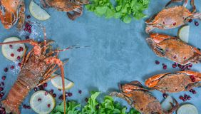 Food frame with crustacean. Lobster, crab, lemon and  pomegranate on background Royalty Free Stock Images