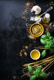 Food frame, italian food background, healthy food concept or ingredients for cooking pesto sauce on a vintage background. Top view with copy space stock image