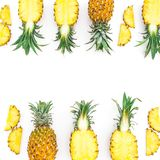 Food frame with juicy pineapple fruits on white background. Flat lay, top view. Food concept royalty free stock photos