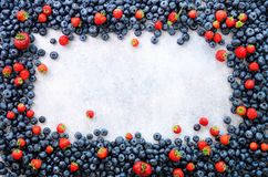 Food frame with mix of strawberry, blueberry. Top view. Vegan and vegetarian concept. Summer berries background.  stock image