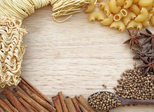 Food frame, noodle, peppercorn, macaroni design on wooden background Stock Photography