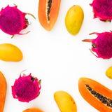 Food frame of papaya, mango and dragon fruits on white background. stock photography