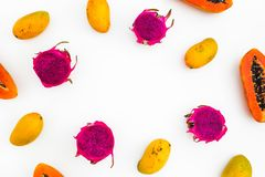 Food frame of papaya, mango and dragon fruits on white background. Flat lay. Top view stock image