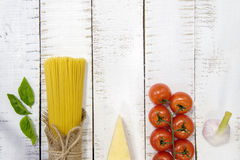 Food frame. Pasta ingredients. Cherry-tomatoes, spaghetti pasta, Royalty Free Stock Image