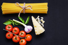 Food frame. Pasta ingredients. Cherry-tomatoes, spaghetti pasta, Stock Photography