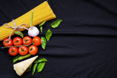 Food frame. Pasta ingredients. Cherry-tomatoes, spaghetti pasta, Royalty Free Stock Photography