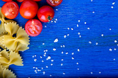 Food frame. Pasta ingredients.  Italian food cooking. Top view. Copy space. Stock Photos