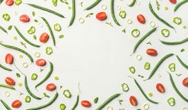 Flat-lay of vegetable slices over white wooden background, copy space. Food frame, pattern, texture, background. Flat-lay of fresh vegetable slices over white Royalty Free Stock Images