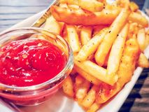 Food. French fries, ketchup with wood background royalty free stock photo
