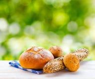 Fresh bread and checkered napkin Stock Photos