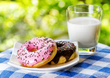 Fresh donuts and glass of milk Stock Images