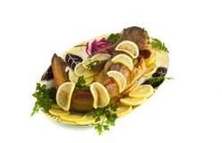 Food - fresh-water catfish (sheatfish) with lemon Royalty Free Stock Image