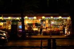 Food and fruit shop at the side walk. Night time Food and fruit shop for tourist at the sidewalk Royalty Free Stock Photo