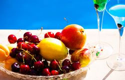 Food. Fruits and berries, blue background Stock Photos