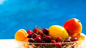 Food. Fruits and berries, blue background Royalty Free Stock Photos