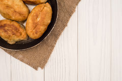 Food in a frying pan. from yeast dough Royalty Free Stock Image