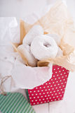 Food gift in a colorful box mini donuts Stock Photos