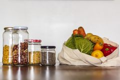 Food in glass jars and reusable bag with groceries. Zero Waste, plastic free concept stock images