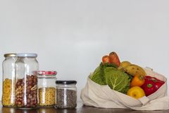 Food in glass jars and reusable bag with groceries. Zero Waste, plastic free concept stock photos