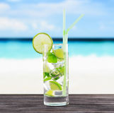 Glass of mojito cocktail on a beach Stock Photography
