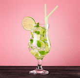 Glass of mojito cocktail on pastel pink background Stock Photo