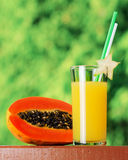 Glass of papaya juice in a garden Stock Photo