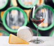 Glass of wine and cheese in winery Royalty Free Stock Photo