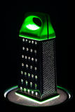 Food grater with green handle Stock Images