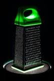 Food grater with green handle Stock Photography