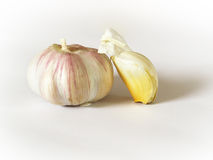 Food. A head of garlic with a clove next Stock Photo