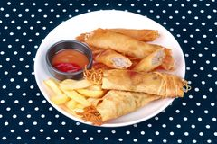 Deep fried spring roll,and frence fries sreved with tomato souce. Food for health,Deep fried spring roll as Por Peai J ,and frence fries sreved with tomato souce royalty free stock images