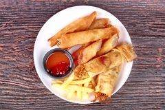Deep fried spring roll,and frence fries sreved with tomato souce. Food for health,Deep fried spring roll as Por Peai J ,and frence fries sreved with tomato souce royalty free stock image