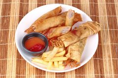Deep fried spring roll,and frence fries sreved with tomato souce. Food for health,Deep fried spring roll as Por Peai J ,and frence fries sreved with tomato souce royalty free stock photography