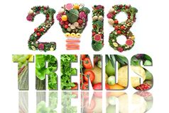 2018 food and health trends. 2018 trends made of fruits and vegetables including a light bulb icon stock photos