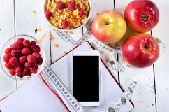 Food for a healthy breakfast: cornflakes, fruit and berries in a Stock Images