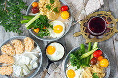Food, healthy Breakfast, porridge, eggs, vegetables, sandwiches with caviar Stock Photo