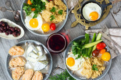 Food, healthy Breakfast, porridge, eggs, vegetables, sandwiches with caviar Stock Images