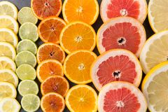 Close up of different citrus fruit slices royalty free stock photos