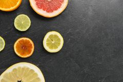 Close up of different citrus fruit slices stock image