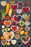Food for a Healthy Heart. With fruit, vegetables, fish, nuts, seeds, pulses, cereal, medicinal spices and herbs. Super food very high in omega 3, antioxidants royalty free stock image