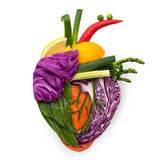 Food for heart. A healthy human heart made of fruits and vegetables as a food concept of smart eating Royalty Free Stock Images