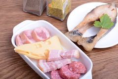 Food high in protein, fish, sausages, cheese Royalty Free Stock Photography