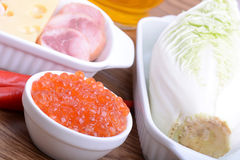 Food high in protein, sausages, cheese, red pepper, red caviar, cabbage Stock Photo