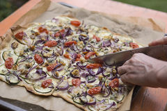 Food: Homemade vegetarian Pizza being sliced Stock Photos