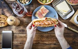 Food. Hot dog, american, barbecue, eating outdoor concept. traditional, unhealthy, snacks, wine, mobile phone stock photography
