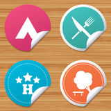 Food, hotel, camping tent and tree signs. Round stickers or website banners. Food, hotel, camping tent and tree icons. Knife and fork. Break down tree. Road Stock Images