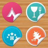 Food, hotel, camping tent and tree signs. Round stickers or website banners. Food, hotel, camping tent and tree icons. Wineglass and fork. Break down tree. Road Stock Photos